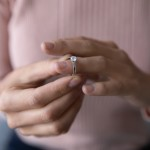 Close,Up,Young,Woman,Taking,Off,Wedding,Ring,,Divorce,Concept,